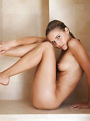 FTV girl demonstrates her shaved pussy