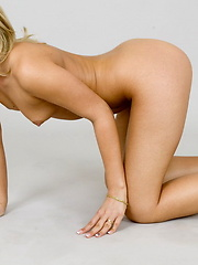 Blonde virgin girl in her first adult photo session
