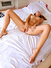 Cute redhead girl touching own shaved hole