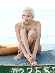Nasty blonde model posing at the wild beach