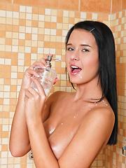 Brunette girl Mia relaxing in the shower
