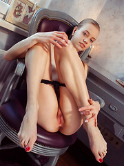 Kimberly Kace displays her slender body, long legs and pink pussy on the chair.