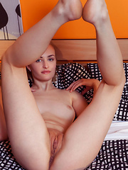 Eidis strips on the bed as she spreads her legs wide open baring her sweet pussy.