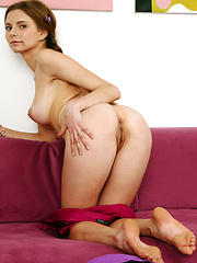 Pig-tailed Yuki strips on the couch baring her delectable pussy.
