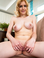 Sexy coed gets hot and horny in the kitchen ticking her tiny clit