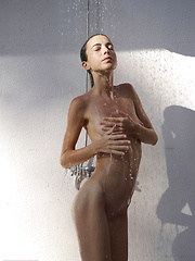 Skinny girl washing her young body