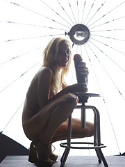 Fashion model sitting on the chair sex toy