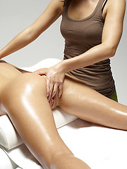 Oiled teenage on the massage table