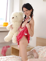 Admirable brunette teen bombshell with teddy bear showing her perky tits and juicy pussy.