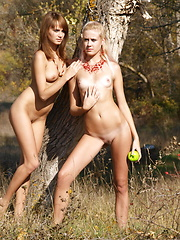 Two teen lesbian cuties playfully seducing each other with their amazing hot nude bodies.