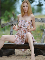Beautiful slim teen cutie with perky small tits stripping and spreading legs on a park bench.