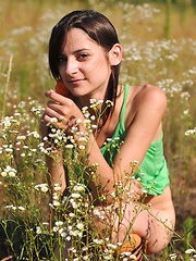 Marvelous teen girl in striped socks undressing and showing slender body on the nature.