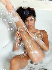 Nubile Nadia Reid fucks her toys while enjoying a bubble bath