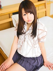 Playful Tokyo girl Hitomi Nawa has shaved pussy