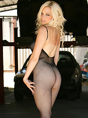 Sara shows off what her mama gave her in this black fishnet one piece (with cut-outs)!