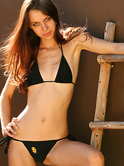 Kami struts her stuff and looks good in and OUT of a black bikini