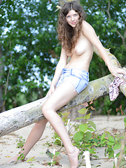 Gorgeous teen honey stripping and posing in the nude with lucky aborigine on the seaside.