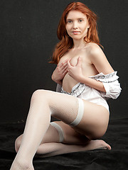 Orabelle evokes a naturally delightful presence as she strips her crisp white shirt and exhibits her fresh, young body with rosy, pink nipples and lush, untrimmed bush.