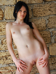 Nichole indulges her fans in a slow and exciting tease, flaunting her slim, slender body, beautiful, puffy breasts and well-toned limbs as she poses against the brick wall.