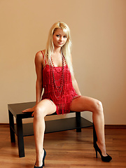 This young beautiful blonde named Grace flaunts her stunning, luscious body with gorgeous, perky tits, clean shaven pussy and shapely legs as she strips her sexy red dress in front of the camera