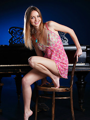 Milagres playfully poses on top of the piano as she strips her smoking hot pink dress and flaunts her gorgeous body, sexy legs and pink moist pussy.