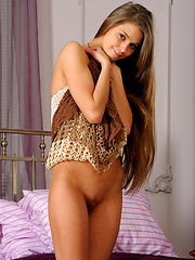 In her bed this cute and charming girl named Kristel displays her nubile body in front of the camera