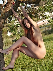 Indiana is a wild girl with a beautiful ass and dazzling eyes, she is playing in the garden.