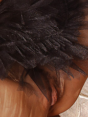 Pretty dancer in a black tutu has real breasts and soft brown hair.
