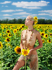 Amidst a large field of sunflowers in full bloom, Adele's natural beauty is the fairest of them all as she confidently poses her gorgeous body with perfectly erect nipples under the warm sun.