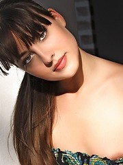 Lorena has dark long hair and cat like eyes , she has red lips and hot nips, and she will have you do flips.