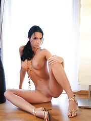Gwen reveals her delicious breasts and lean and exotic body wearing nothing but beads and heels.