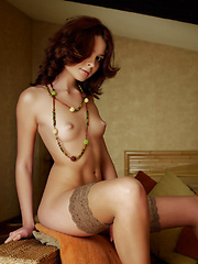 Earth tones are all over this set with a soft brunette and a light tan all over her body.