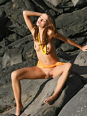 Eufrat is on the comeback trail, getting nude on the beach and posing with the dark rocks as contrast to her soft skin.