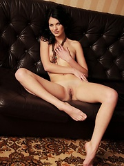 The sleek, modern design of the black leather couch constrasts Nichole\'s feminine and elegant anatomy, with her laid-back, natural beauty, slim body, and scrumptiously puffy nipples.