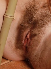 Milena shows furry pussy