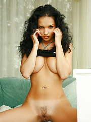 Jenya exposes her fierce side showing her generous breasts and a mean attitude.
