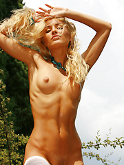 Liza showcases her seductive allure and smoking hot body as she poses eroticaly in the outdoors.