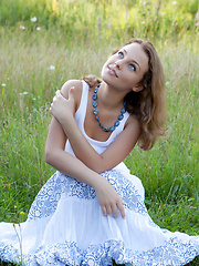 Even in the outdoors, wearing a casual flowing dress, Nikia proves she has great potential to seduce anyone anywhere anytime, with a gorgeous slender body and enticing smile.