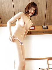 Asian girl undressing