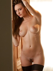 Dakota Rae - removes her top in a dim, sunlit room
