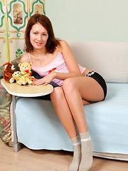 An amazing horny girl hugging her attractive teenage body