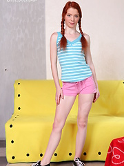 Gorgeous redheaded teen cutie gets banged hard on a couch and catches cum with her mouth.