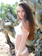 Jasmin A takes off her white lingerie, allowing us to get a clean look of her lusty body with smooth, shaved assets