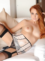 Lucy Anne in pink lingerie and black stockings