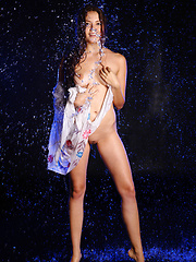 Norma A pulls off her white dress and gets her body wet