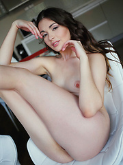 Lukki Lima showcases her long, sensual legs with porcelain skin, pink and puffy nipples, and round butt