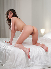 Sultry Dakota A in provocative, wide open poses on top of the bed