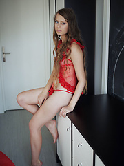 Milana K strips off her sexy red nighty