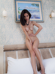 Seductive and simply stunning Helen H in her black lingerie, posing on top of the bed
