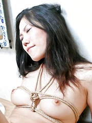 Yui Komine Asian with tits in ropes gets fingers in her wet pussy